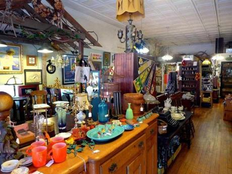 In Wakefield, R.I., Cheshire Cats, left, displays a variety of antiques and collectibles.